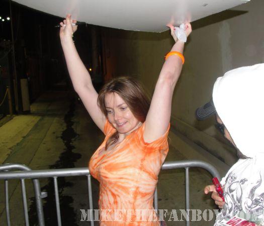 Annette Slomka after having her Drew Barrymore poster signed