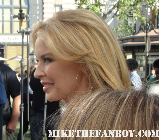 Kylie Minogue Signing Autographs for Fans while being interviewed