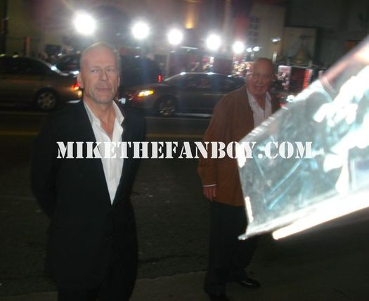Bruce Willis Screws fans over at the Red Premiere In Los Angeles