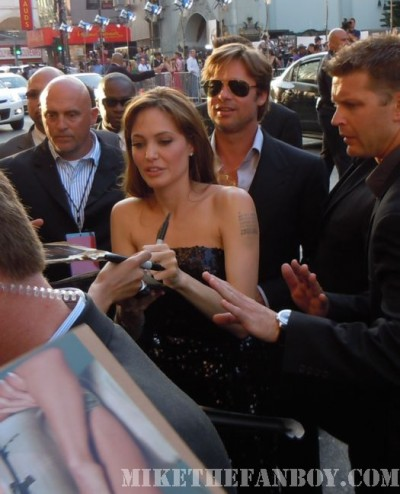Angelina jolie and Brad Pitt signing for fans at the salt premiere