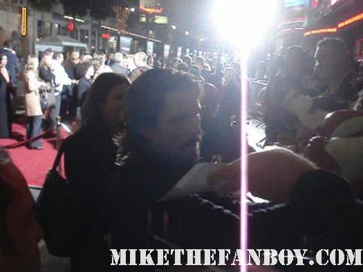 Christian Bale signing autographs at the fighter premiere in hollywood signed poster