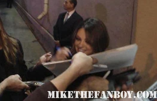 Mila Kunis star of black swan book of eli that 70's show signing autographs for fans rare hand signed