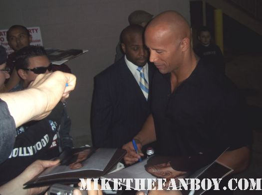 dwayne johnson the rock stops to sign autographs after a talk show taping to promote fast five  signed autograph promo get smart wrestler sexy hot rare