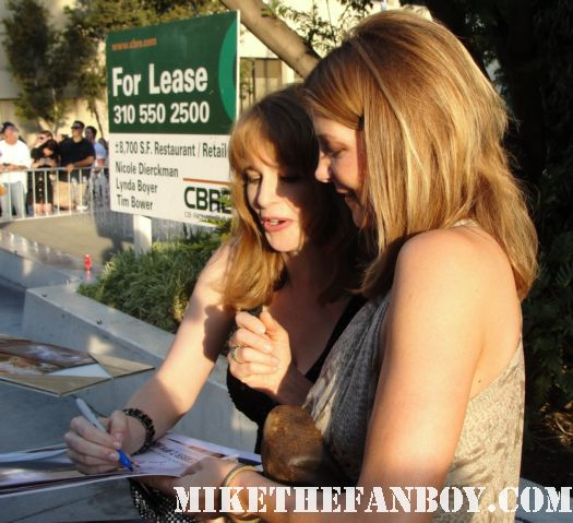 Annie Fitzgerald and  Stephanie Erb signing autographs for fans at the true blood season 4 world premiere red carpet rare promo poster true colors premiere rare fangtasia promo sign autographs