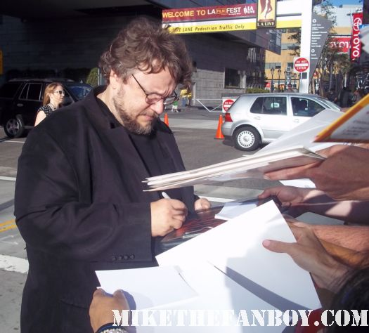 Guillermo del Toro signing autographs for fans at the are you afraid of the dark world movie premiere at the los angeles film festival hobbit rare hellboy