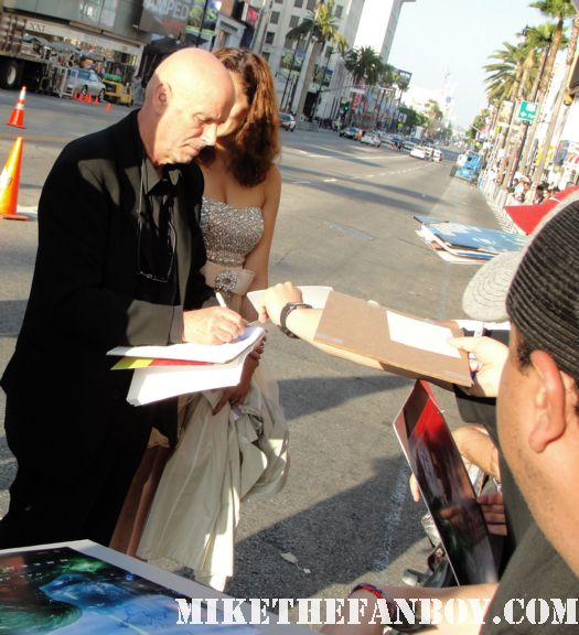martin campbell director of green lanter signs autographs at the green lantern premiere from green lantern crosses to sign autographs for the fans at the barricades hot sexy rare promo signed autograph promo poster