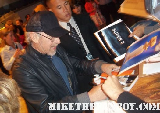 steven spielberg director of E.T. Jurassic Park hook signing autographs for fans at the super 8 movie premiere in westwood ca director indiana jones rare promo