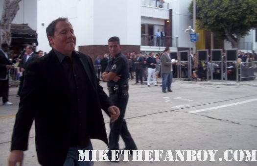 jon favreau from iron man signing autographs for fans at the super 8 movie premiere in westwood ca director