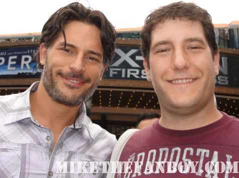 true blood star joe manganiello aka alcide the werewolf takes a fan photo with mike the fanboy at a taping of extra at the grove