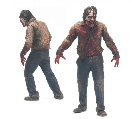 McFarlane Toys the walking dead series 1 action figure collection Zombie Biter - features a deer meat accessory and a spring-loaded moving jaw