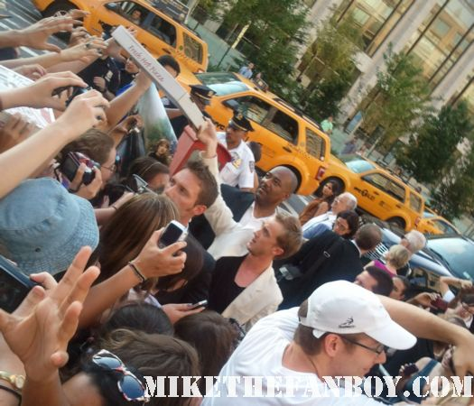 tom felton delivering pizza's to the waiting fans at the harry potter and the deathly hallows part 2 new york movie premiere waiting fans for the red carpet daniel radcliffe