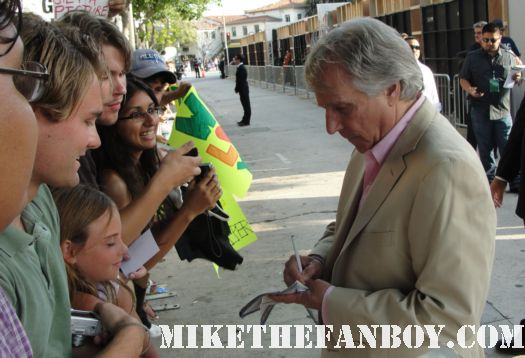 henry winkler from happy days and scream stops to sign autographs for fans at the zookeeper world movie premiere in westwood rare