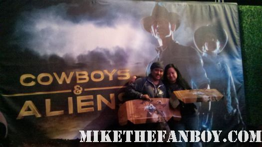 erica from mike the fanboy at the autograph signed signature ron howard and cast harrison ford olivia wilde daniel craig Premiere party red carpet at the cowboys and aliens world movie premiere san diego ca comic con 2011