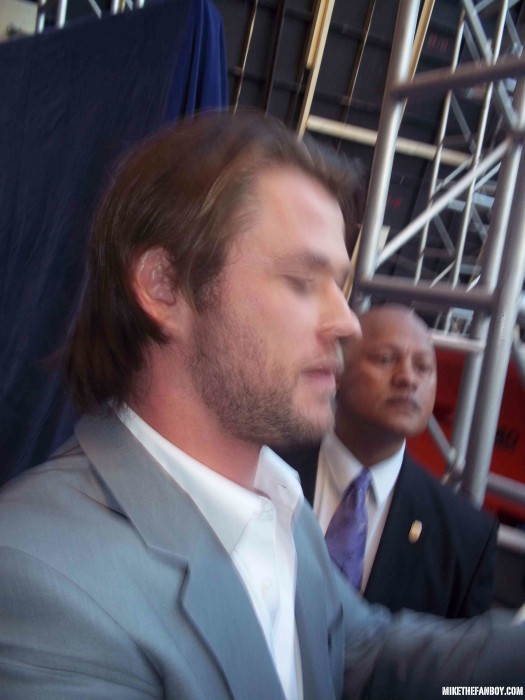 Picture The world movie premiere of Captain America the First Avenger at the el capitan theatre in hollywood chris hemsworth signing autographs for fans hot sexy photo shoot rare thor signed autograph hot sexy rare shirtless promo damn fine