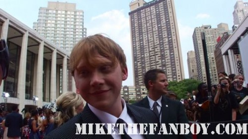 Rupert Grint signing autographs for fans at the the harry potter and the deathly hallows part 2 new york movie premiere waiting fans for the red carpet daniel radcliffe sexy rare