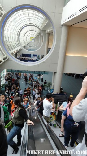 san-diego-comic-con-2010-sdcc-2010-main-exhibiation-hall comic con logo escalator random costumes promo swag hot rare sdcc 2011