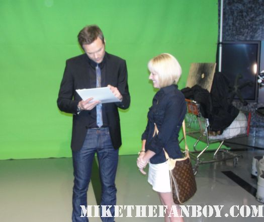 On the set of the soup with joel mchale! Lindsay getting her photo autographed by joel mchale community rare promo green screen