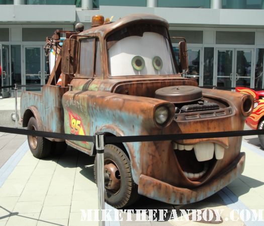 D23 2011 mater in front of the convention center with lightning mcqueen rare promo