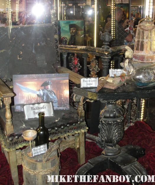 D23 2011 walt disney pirates of the caribbean on stranger tides props and costumes rare johnny depp jack sparrow penelope cruz sword costume compass Penelope Cruz's  costume and gun from Pirates Caribbean anjelica the black pearl in a bottle