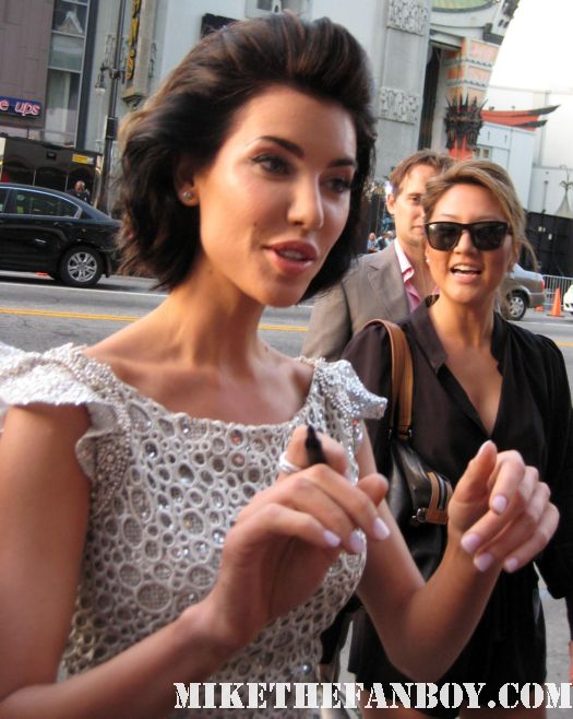 Jaqueline Macinnes-Wood signing autographs for fans at the world movie premiere of Final destination 5