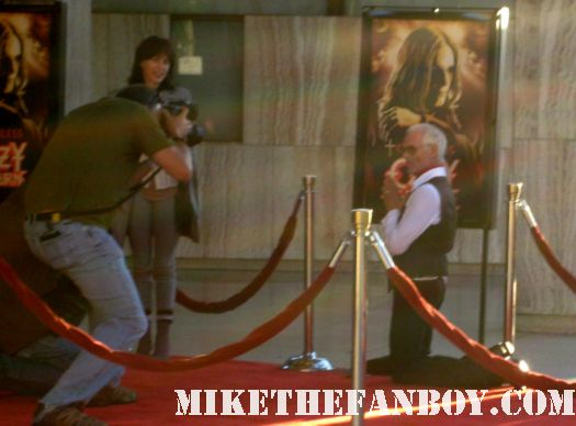 the red carpet at God Bless Ozzy Osbourne rare sharon osbourne kelly osborne jack osbourne michael des barres kneeling in front of ozzy's photo on the red carpet