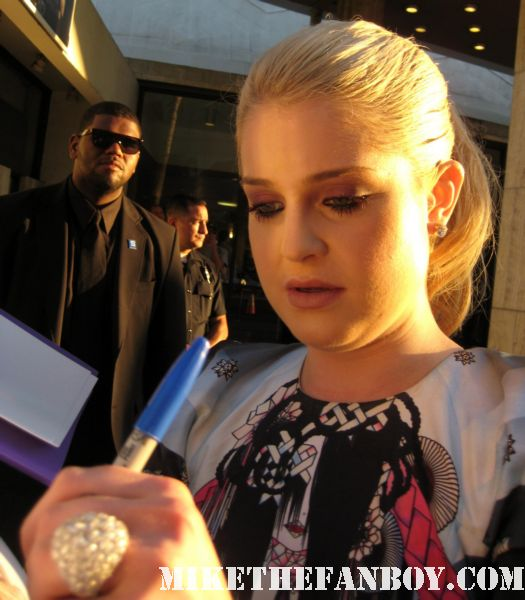 the red carpet at God Bless Ozzy Osbourne rare sharon osbourne kelly osborne jack osbourne kelly osbourne signing autographs for the crowd