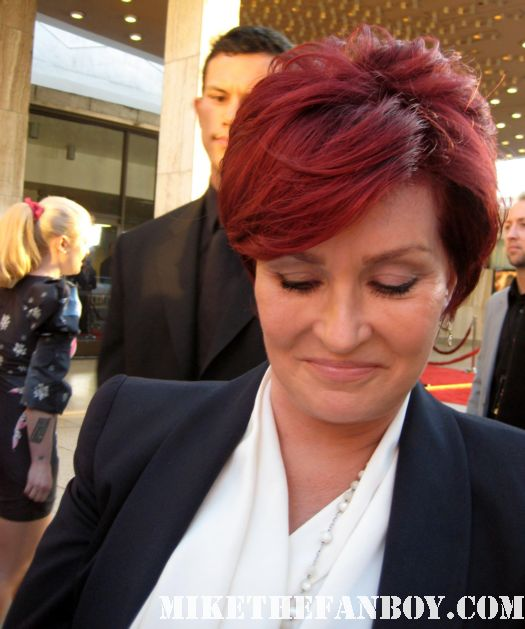 the red carpet at God Bless Ozzy Osbourne rare sharon osbourne kelly osborne jack osbourne sharon osbourne signing autographs for the crowd