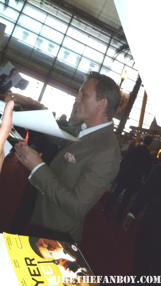 The Cowboys and Aliens UK movie premiere at empire magazines big screen event daniel craig signing autographs for fans the girl with the dragon tatoo