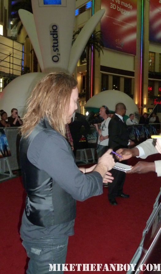 The Cowboys and Aliens UK movie premiere at empire magazines big screen event Tim Minchin signing autographs for fans Tim Minchin signed autograph