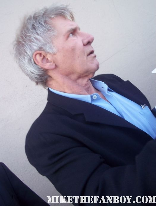 Indiana Jones star Mr. Harrison Ford stops to sign autographs for waiting fans at a television talk show cowboys and aliens