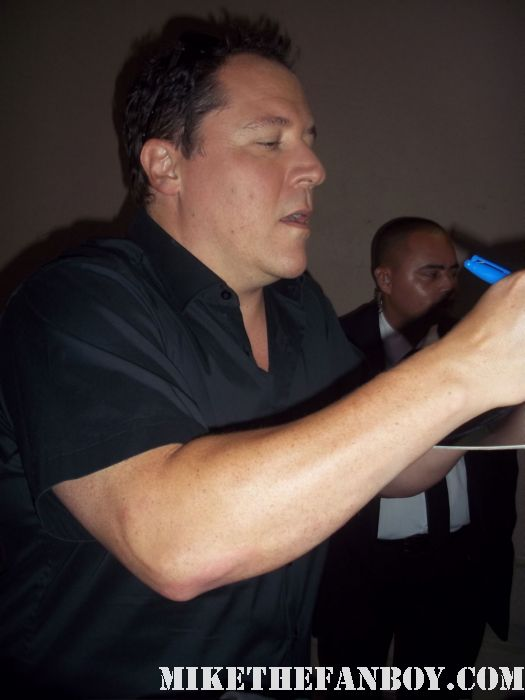 iron man director jon favreau stops to sign autographs for waiting fans at a television talk show cowboys and aliens