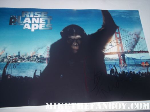 cast signed autograph rise of the plant of the apes mini poster rare promo hot tom felton andy serkis frieda pinto signing autographs for fans at the rise of the planet of the apes premiere rare signed autograph hot sexy rare promo photo shoot damn sexy