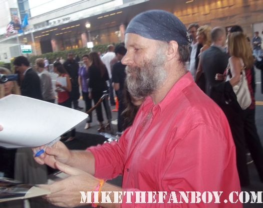 Marcus Nispel signs autographs for fans at the conan the barbarian red carpet world movie premiere with jason momoa lisa bonet rose mcgowan rachel nichols ron perlman