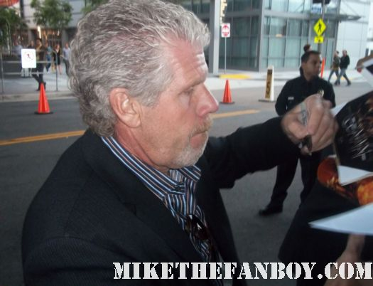ron perlman signs autographs for fans at the conan the barbarian red carpet world movie premiere with jason momoa lisa bonet rose mcgowan rachel nichols ron perlman