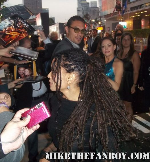 jason momoa and lisa bonet sign autographs for fans at the conan the barbarian red carpet world movie premiere with jason momoa lisa bonet rose mcgowan rachel nichols ron perlman
