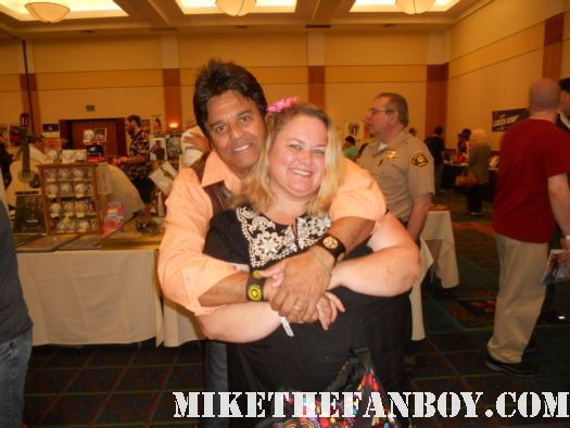 Erik Estrada from chips at the burbank hollywood collector's show at the hollywood collector's show poses for a fan photo with pinky from pretty in pinky