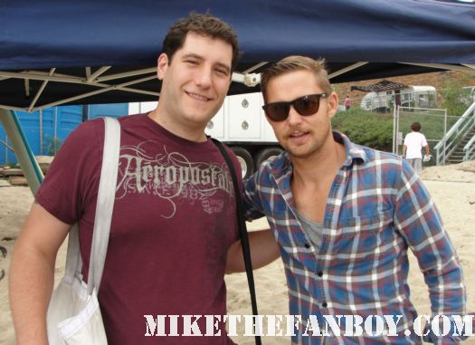 Brian Geraghty from The Hurt Locker poses for a fan photo with mike the fanboy at the 6th annual surfrider benefit