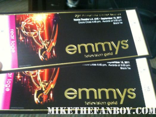 mike the fanboy's pretty in pinky at the 2011 emmy awards holding an emmy statue in the foyer emmy awards tickets