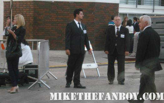 a security guard that looks like bruno mars at the in time world movie premiere the crowd at the in time world movie premiere anushika stealing cbs pen the crowd at the in time world movie premiere in time car prop in time world movie premiere red carpet with justin timblerlake, amanda seyfried matt bomer johnny galecki hot sexy rare promo