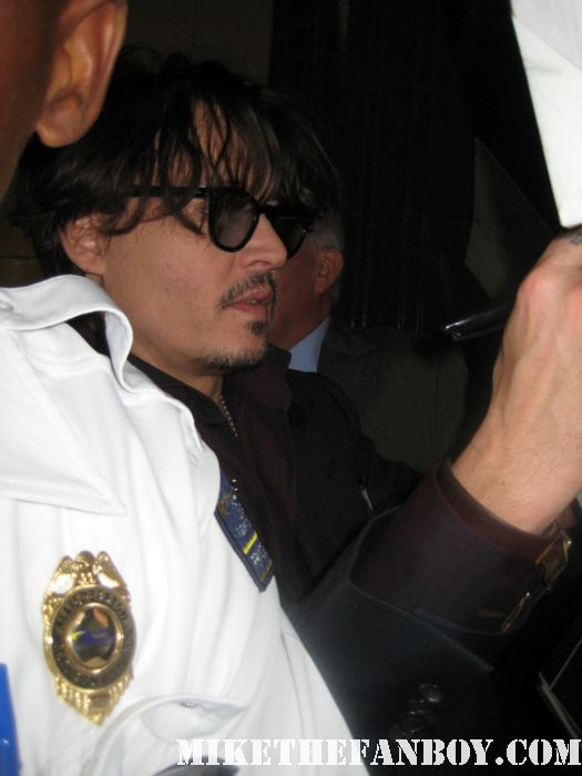 johnny depp arriving to the rum diary world movie premiere the red carpet or black carpet at the rum diary world movie premiere with johnny depp signing autographs for the fans!