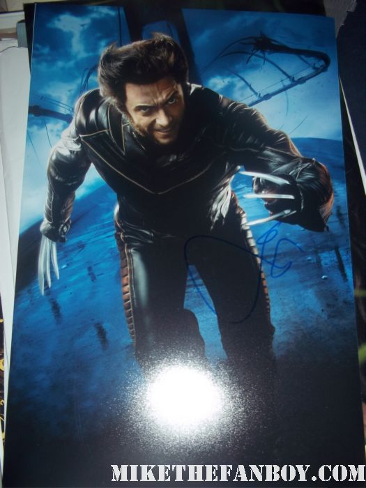 hugh jackman signed autograph wolverine rare photo the real steel world movie premiere after party with hugh jackman hugh jackman signing autograph for the crowd at hugh jackman and shawn levy at the real steel premiere The Real Steel US World Premiere Hugh Jackman Dakota Goyo Evangeline Lilly Anthonie Mackie