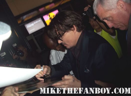 johnny depp arriving to the rum diary world movie premiere the red carpet or black carpet at the rum diary world movie premiere with johnny depp signing autographs for the fans! sexy johnny depp rare promo