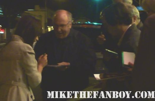 felicity jones signing autographs for fans before  at a q and a with anton yelchin at the aero theater in santa monica ca