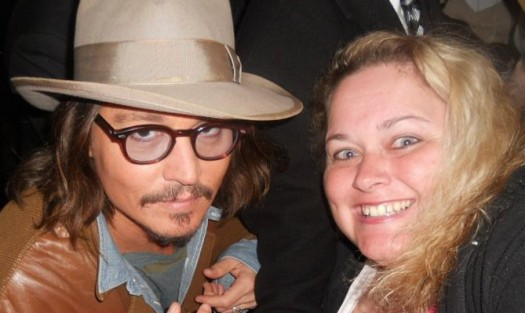 Johnny Depp with mike the fanboy columnist pretty in pinky at the rango premiere.