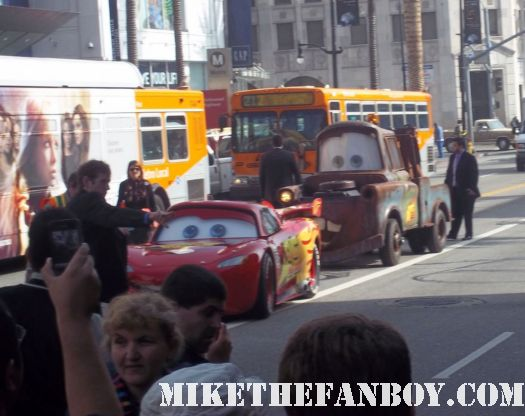 john lasseter walk of fame star ceremony lightning mcqueen and mater arriving down hollywood blvd.