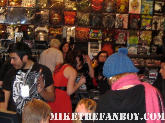Ashley Greene signing autographs for fans at the hot topic twilight dvd release party hot sexy rare promo