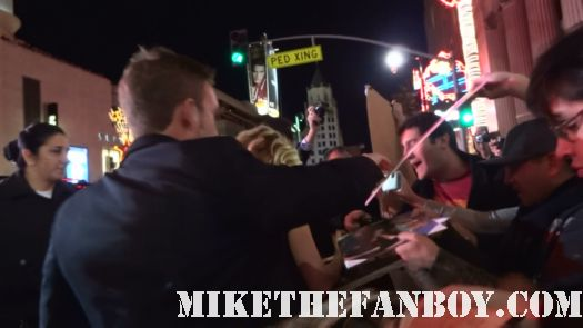 Michelle Pfeiffer arrives the new years eve world movie premiere and signs autographs for fans