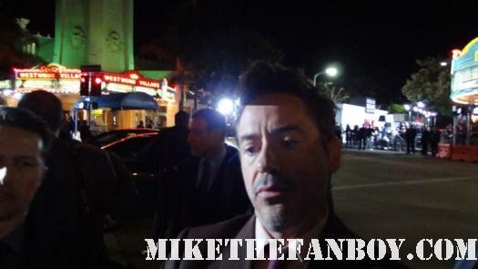 Robert Downey Jr signing autographs for fans at sherlock holmes a game of shadows world movie premiere with robert downey jr jared harris rachel mcadams