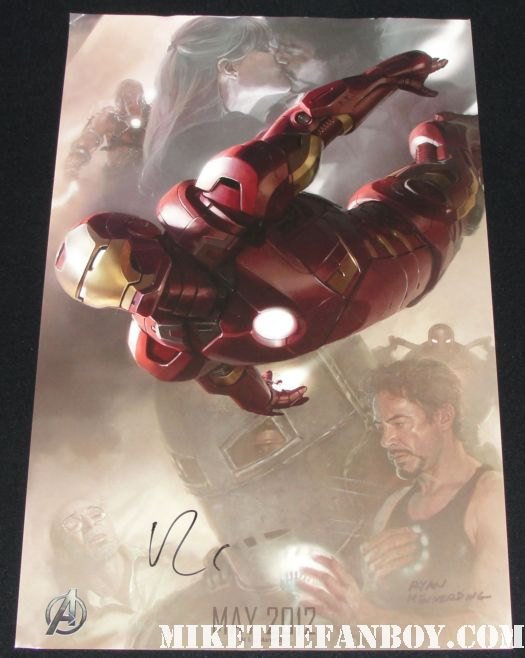 robert downey jr signed autograph san diego comic con iron man the avengers concept art promo poster Robert Downey Jr signing autographs for fans at sherlock holmes a game of shadows world movie premiere with robert downey jr jared harris rachel mcadams