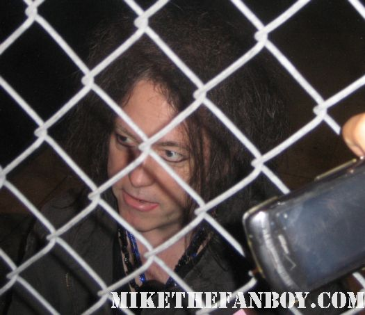 robert smith from the cure signing autographs for fans before a show at the pantages theatre in hollywood